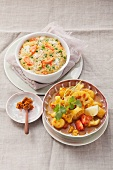 Millet casserole with peas and carrots and cauliflower-potato curry