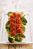 Roast tomatoes on bean and broccoli salad