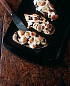 Bread topped with chocolate cream, bananas and marshmallows