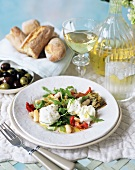 Artichoke salad with mozzarella and wild rocket
