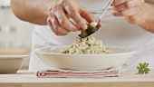 Porcini mushroom risotto being prepared (German Voice Over)