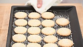 Freshly baked sugared biscuits on a baking tray