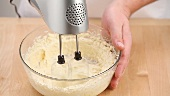 Making biscuit dough with an electric whisk