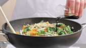 Seasoning stir-fried vegetables with soy sauce