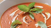 Cream of tomato soup with crème fraîche and fresh basil