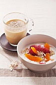 Cream cheese muesli with oranges and raspberries and sea buckthorn milk with oats