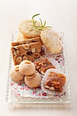 Assorted cookies on a glass tray