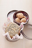 Poppy seed cookies and peanut cookies in a cookie tin