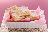 Cream cheese squares in a dish with a pink serviette
