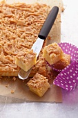 Blondies (white chocolate cookies) with almonds