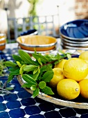 Lemons and laurel in a tray