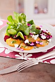 Carpaccio of red and yellow beetroot with lamb's lettuce and goat cheese