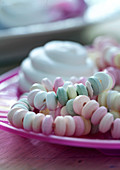 A candy necklace on a plate