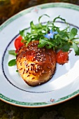Fried goose liver with pine nuts and a side salad