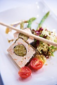 Salmon terrine with a mixed leaf salad and cherry tomatoes