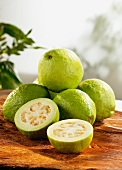 Several guavas on wooden board