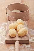 Potato gnocchi on a gnocchi board