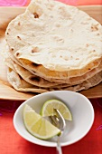 Wheat tortillas and lime wedges