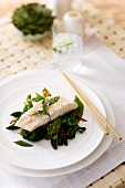 Steamed fish fillet with leafy vegetables, garlic and ginger (Asia)