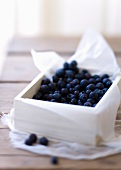 Fresh blueberries in a wooden box