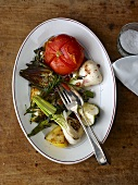 Vegetable platter with artichokes, garlic and tomatoes
