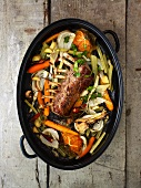 Rack of lamb with vegetables in a roaster