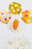 Cake pops decorated for spring (hearts, butterflies, carrots)