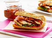Baguette sandwich with chicken, apple and plums