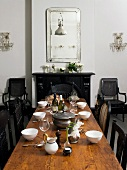 Set table in dining room with antique furniture
