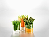 Green beans, carrots and asparagus in glasses with dips