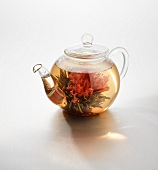 Tea with tea flower in glass jug