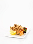 Salmon and vegetables in cederwood rolls
