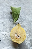 Half a quince with a leaf