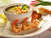 Avocado soup with shrimp kebabs