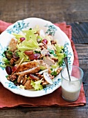Salad with chicken, walnuts and grapes with blue cheese dressing
