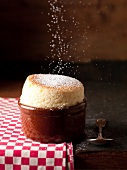 Sprinkling a souffle with sugar