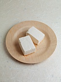 Tofu on a wooden plate