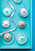 Pastel colored meringues with ribbon
