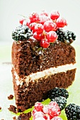 A slice of chocolate cake with summer berries