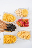 Assorted varieties of pasta in glass storage containers