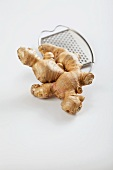 Fresh ginger root with a grater