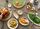 Roast turkey stuffed with lemon grass and assorted side dishes
