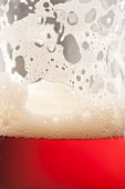 Glass of Amber Ale with Foam on Glass; Close Up