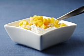 Square Dish of Cottage Cheese Topped with Mango