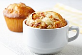 Apple Cinnamon Muffin Baked in a Tea Cup; Muffin in Background