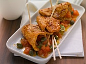 Pork skewers with tomato and caper salsa