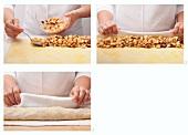 Preparing apple strudel: roll up filled strudel pastry