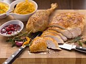 Sliced roast turkey with cranberry sauce and sweet potato puree