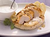 Tandoori chicken with cauliflower, natural yoghurt and flatbread