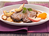 Roast beef with carrots and pears in Burgundy sauce